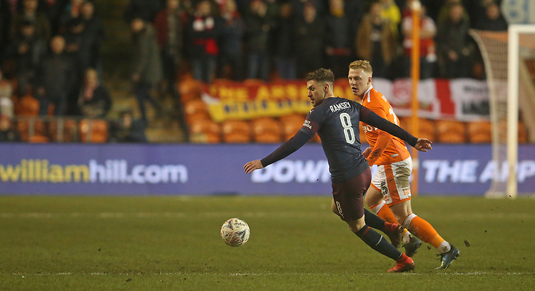 Arsenal's Aaron Ramsey shields the ball from Blackpool's Callum Guy<br /> <br /> Photographer Stephen White/CameraSport<br /> <br /> Emirates FA Cup Third Round - Blackpool v Arsenal - Saturday 5th January 2019 - Bloomfield Road - Blackpool<br />  <br /> World Copyright © 2019 CameraSport. All rights reserved. 43 Linden Ave. Countesthorpe. Leicester. England. LE8 5PG - Tel: +44 (0) 116 277 4147 - admin@camerasport.com - www.camerasport.com