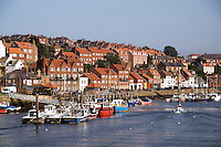Harbor with fishing boats, town of Whitby, England