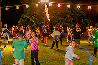Kids play while adults dance at the Hakalau Jodo Mission Bon Dance, Big Island of Hawai'i 2014, where local families come each year to celebrate their ancestors.