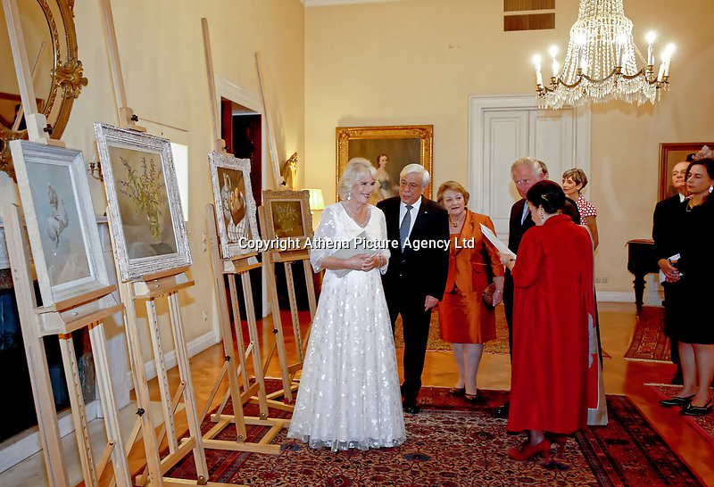 Pictured: Prince Charles and the Duchess of Cornwall are shown a collection of paintings by Greek President Prokopis Pavlopoulos and wife Vlasia after the official state dinner at the Presidential Mansion in Athens, Greece. Wednesday 09 May 2018 <br /> Re: Official visit of HRH Prnce Charles and his wife the Duchess of Cornwall to Athens, Greece.