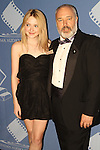 DAKOTA FANNING & EDWARD MOSKOWITZ. Arrivals to the 46th Annual Cinema Audio Society Awards at the Millennium Biltmore Hotel in downtown Los Angeles. Los Angeles, CA, USA. February 27, 2010.
