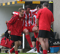 Grant Carnochan carried off after being injured in the Huntly v Wigtown & Bladnoch William Hill Scottish Cup 1st Round match, at Christie Park, Huntly on 25.8.12.
