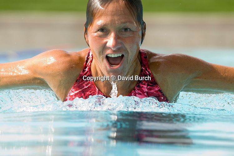 Woman swimming,doing breast stroke