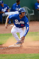 Alex Santana #21 of the Ogden Raptors slides safely into third base during the Pioneer League game against the Idaho Falls Chukars at Lindquist Field on June 23, 2013 in Ogden, Utah. (Stephen Smith/Four Seam Images)