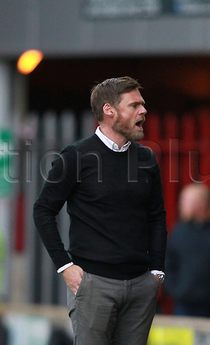 7th October 2017, Glanford Park, Scunthorpe, England; EFL League One football, Scunthorpe versus Wigan; Scunthorpe United Manager Graham Alexander complains to the 4th official