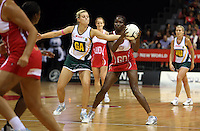 01.11.2012 England's Ama Abgeze and South Africa's Maryka Holzhausen in action during the netball test match between England and South Africa as part of the Quad Series played at the Claudelands Arena in Hamilton. Mandatory Photo Credit ©Michael Bradley.