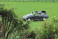 Crashed car, in a field with broken hedge, Chipping, Lancashire.