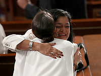 United States Representative Rashida Tlaib (Democrat of Michigan) hugs US Representative Alexandria Ocasio-Cortez (Democrat of New York) prior to US President Donald J. Trump delivering his second annual State of the Union Address to a joint session of the US Congress in the US Capitol in Washington, DC on Tuesday, February 5, 2019.<br /> Credit: Alex Edelman / CNP
