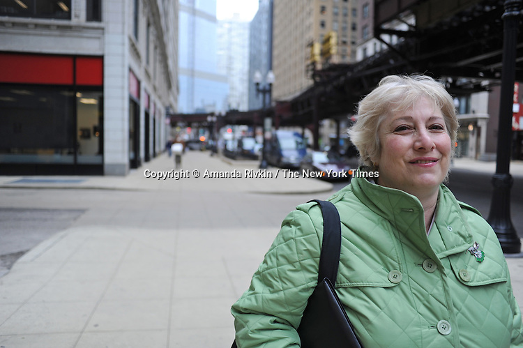 Rae Lynn Schneider, 61, stands outside the offices of the National Able Network in downtown Chicago, Illinois on March 24, 2009.  A retired former Chicago Public School teacher, Schneider returned to the workforce last fall working briefly in sales at American Girl Place, a job Schneider said she loved but given its seasonal nature Schneider has been forced back into the job market and is retooling her resume and building her skill base with the assistance of National Able Network programs.