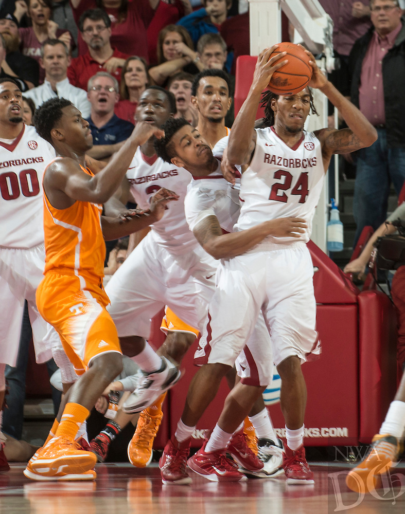 NWA Democrat-Gazette/ANTHONY REYES &bull; @NWATONYR<br /> Michael Qualls, Arkansas junior, grabs a defensive rebound in the closing minutes against Tennessee Tuesday, Jan. 27, 2015 in Bud Walton Arena in Fayetteville. The Razorbacks won 69-64.