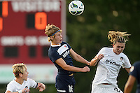 Sky Blue FC midfielder Sophie Schmidt (16) goes up for a header. Sky Blue FC defeated the Washington Spirit 1-0 during a National Women's Soccer League (NWSL) match at Yurcak Field in Piscataway, NJ, on August 3, 2013.