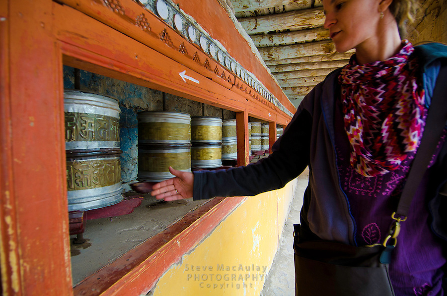 Spinning the prayer wheels at Hemis Monastery in Leh, Ladakh, India.
