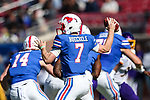 Southern Methodist Mustangs quarterback Shane Buechele (7) in action during the game between the East Caroline Pirates  and the SMU Mustangs at the Gerald J. Ford Stadium in Fort Worth, Texas.