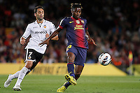 02/09/2012 - Liga Football Spain, FC Barcelona vs. Valencia CF Matchday 3 - Alexander Song controls a ball with Jonas on his back
