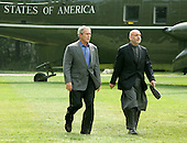 U.S. President George W. Bush (L) and Afghan President Hamid Karzai walk to a joint press conference in Camp David Maryland, USA on Monday 06 August 2007. Karzai's two-day visit to the Presidential mountain retreat included discussions of trouble at home, including a hostage crisis and a resurgent Taliban.