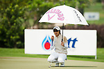 CHON BURI, THAILAND - FEBRUARY 16:  Eun Hee Ji of South Korea shelters from the sun under her umbrella on the 16th green during day one of the LPGA Thailand at Siam Country Club on February 16, 2012 in Chon Buri, Thailand.  Photo by Victor Fraile / The Power of Sport Images