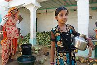 mother and child in desert village (Masurdi) home court close to Jaisalmer, Rajastan, India