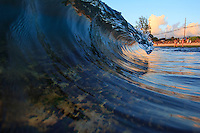 An evening glassy wave breaks at Laniakea Beach on the North Shore of O'ahu.