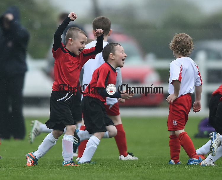 Youngsters from Bridge United and Newmarket Celtic show their skills in the half time game  during the Cup final at Doora. Photograph by John Kelly.