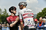 Eddie Dunbar (IRL) Team Ineos and Krists Neilands (LAT) Israel Cycling Academy stop for a chat at sign on before the start of Stage 13 of the 2019 Giro d'Italia, running 196km from Pinerolo to Ceresole Reale (Lago Serrù), Italy. 24th May 2019<br /> Picture: Fabio Ferrari/LaPresse | Cyclefile<br /> <br /> All photos usage must carry mandatory copyright credit (© Cyclefile | Fabio Ferrari/LaPresse)