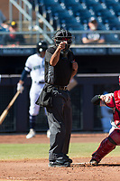 Home plate umpire Nestor Ceja calls a strike during an Arizona Fall League game between the Scottsdale Scorpions and the Peoria Javelinas at Peoria Sports Complex on October 18, 2018 in Peoria, Arizona. Scottsdale defeated Peoria 8-0. (Zachary Lucy/Four Seam Images)