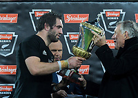 NZ Rugby president Maurice Trapp hands the series trophy to All Blacks captain Sam Whitelock after the Steinlager Series international rugby match between the New Zealand All Blacks and France at Westpac Stadium in Wellington, New Zealand on Saturday, 16 June 2018. Photo: Dave Lintott / lintottphoto.co.nz