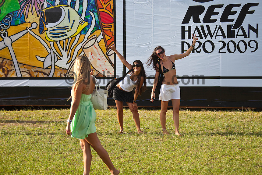 "HALEIWA, HI (Nov. 18, 2009) -- The world's first $1,000,000 surf series, the Vans Triple Crown of Surfing presented by Rockstar Energy Drink, got underway again today on Oahu's North Shore today with the battle for the record ""Triple Threat"" prize purse. Haleiwa is playing host to the first jewel in the crown: the Reef Hawaiian Pro, a prime 6-star men's ASP World Qualifying Series event...Competition will got underway at 8 a.m. in the 3- to 5-foot surf with the completion of round two and ran 14 heats of round three...The northern hemisphere winter months on the North Shore signal a concentration of surfing activity with some of the best surfers in the wolrd taking advantage of swells originating in the stormy Northern Pacific. Notable North Shore spots include Waimea Bay, Off The Wall, Backdoor, Log Cabins, Rockpiles and Sunset Beach... Ehukai Beach is more  commonly known as Pipeline and is the most notable surfing spot on the North Shore. It is considered a prime spot for competitions due to its close proximity to the beach, giving spectators, judges, and photographers a great view...The North Shore is considered to be one the surfing world's must see locations and every December hosts three competitions, which make up the Triple Crown of Surfing. The three men's competitions are the Reef Hawaiian Pro at Haleiwa, the O'Neill World Cup of Surfing at Sunset Beach, and the Billabong Pipeline Masters. The three women's competitions are the Reef Hawaiian Pro at Haleiwa, the Gidget Pro at Sunset Beach, and the Billabong Pro on the neighboring island of Maui...Photo: Joliphotos.com"