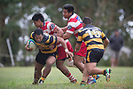 Sepu Taufa turns in Tenna Sauileoge's tackle to look for support from Reece Joyce.  Counties Manukau Premier Club Rugby game between Bombay and Karaka, played at Bombay, on Saturday March 15 2014. Karaka won the game 39 - 12 after leading 13 - 5 at halftime.  Photo by Richard Spranger
