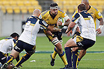 Hurricanes' lock Jeremy Thrush, centre, looks to run past the tackle of ACT Brumbies' hooker Stephen Moore, left, in the Super Rugby match at Westpac Stadium, Wellington, New Zealand, Friday, March 07, 2014. Credit: Dean Pemberton
