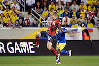 Tim Ream (14)  of the United States. The men's national team of the United States (USA) was defeated by Ecuador (ECU) 1-0 during an international friendly at Red Bull Arena in Harrison, NJ, on October 11, 2011.