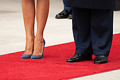 The shoes of United States President Donald J. Trump and first lady of the United States Melania Trump are seen as they emerge from the White House as the await the arrival of French President Emmanuel Macron and first lady of France Brigette Macron on the South Lawn of the White House during the French State Visit to the United States on April 24, 2018 in Washington, DC. Credit: Alex Edelman / Pool via CNP