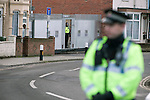 "Portsmouth 1 Southampton 1, 18/12/2012. Fratton Park, Championship. A police officer on patrol at the end of a closed-off street outside Fratton Park stadium before Portsmouth take on local rivals Southampton in a Championship fixture. Around 3000 away fans were taken directly to the game in a fleet of buses in a police operation known as the ""coach bubble"" to avoid the possibility of disorder between rival fans. The match ended in a one-all draw watched by a near capacity crowd of 19,879. Photo by Colin McPherson."