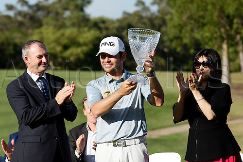 28.02.2016. Perth, Australia. ISPS HANDA Perth International Golf. Louis Oosthuizen (ZAF) receives his trophy after winning the tournament by one shot.