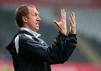 Swansea City manager Graham Potter shouts instructions to his team from the dug-out during the Sky Bet Championship match between Swansea City and Preston North End at the Liberty Stadium, Swansea, Wales, UK. Saturday 11 August 11 2018