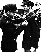 Major Jimmy Stewart receives a Distinguished Flying Cross.  The patch on the shoulder of his uniform coat acknowledges that Stewart was assigned to the 8th Air Force at the time.  Stewart died on July 2, 1997 from a blood clot in his lung. .Credit: U.S. Air Force via CNP