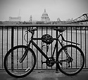 View of St Paul's Cathedral with a bicycle in the foreground, London, UK.