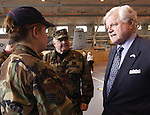 U.S. Sen. Edward M. Kennedy, D-Mass., talks with Staff Sgt. Tracy L. Oleksak of the 104th Fighter Wing at Barnes Municipal Airport in Westfield yesterday. Maj. Gen. George W. Keefe, adjutant general of the Massachusetts National Guard, stands by...