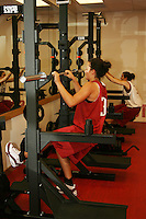 12 October 2005: Jillian Harmon working out in the weight room in Maples Pavilion in Stanford, CA.