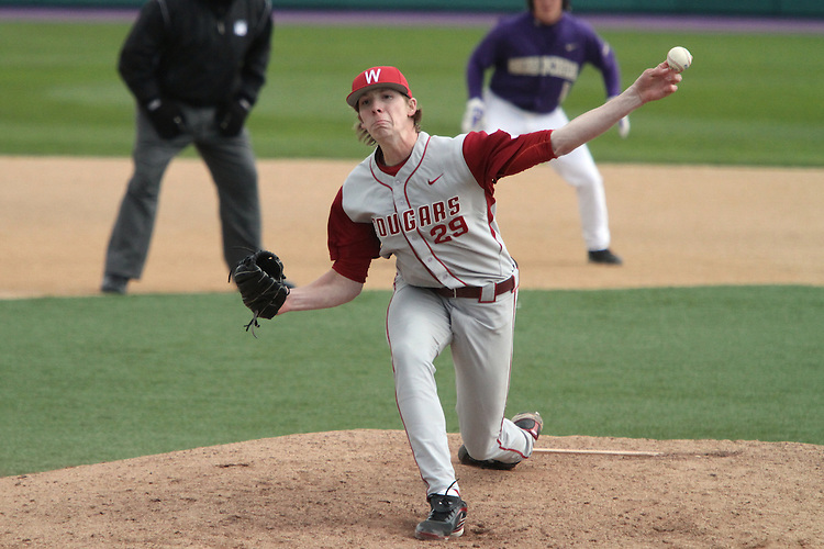 Adam Conley (#29), Washington State sophomore, uncorks a pitch during a critical part of the Cougars Pac-10 conference, 12 inning victory over arch-rival Washington in Seattle, Washington, on April 3, 2010.