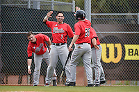 Illinois State Redbirds Jack Czeszewski (25) high fives Dennis Colon (1) after scoring a run during a game against the Georgetown Hoyas on March 7, 2015 at North Charlotte Regional Park in Port Charlotte, Florida.  Illinois State defeated Georgetown 2-1.  (Mike Janes/Four Seam Images)