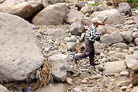 Sirilo Jos&eacute; P&eacute;rez Fuentes walks among boulders from a landslide that killed his son and destroyed his house on October 5. Fifty-two people were killed and six others went missing in five minutes during the Piedra Grande landslide. Townspeople said no one from governmental or non-governmental agencies has visited the town since the disaster. Torrential rains associated with Hurricane Stan inundated parts of Central America in early October, causing flooding and mudslides across western Guatemala.<br />