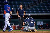AZL Padres 1 catcher Chandler Seagle (11) is examined by athletic trainer Maritza Castro during an Arizona League game against the AZL Cubs 1 on July 5, 2019 at Sloan Park in Mesa, Arizona. The AZL Cubs 1 defeated the AZL Padres 1 9-3. (Zachary Lucy/Four Seam Images)