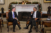 United States President Barack Obama, right, meets with Juan Manuel Santos, Colombia's president, in the Oval Office of the White House in Washington, D.C., U.S., on Tuesday, Dec. 3, 2013. Obama and Santos said the free trade accord that took effect last year has been a boon for both countries and that relations are at a high point. <br /> Credit: Andrew Harrer / Pool via CNP