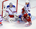 23 January 2010: New York Rangers' goaltender Matt Zaba makes a third period save against  the Montreal Canadiens as Travis Moen (32) slides into the crease at the Bell Centre in Montreal, Quebec, Canada. The Canadiens shut out the Rangers 6-0. Mandatory Credit: Ed Wolfstein Photo