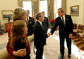 United States President George W. Bush congratulates United States Senator Mike DeWine,(Republican of Ohio), on S. 650, the Pediatric Equity Research Act of 2003, in the Oval Office in Washington, DC on  December 16, 2003. Senator DeWine's daughter and wife, Fran, are pictured at the left. Also pictured are Senate Majority Leader Bill Frist, (Republican of Tennessee), left, and United States Health and Human Services Secretary Tommy Thompson. The act gives the Food and Drug Administration the authority to require drug companies to conduct safety tests on pharmaceuticals that are to be administered to children. The President signed the bill into law December 3, 2003.  <br /> Mandatory Credit: Tina Hager / White House via CNP