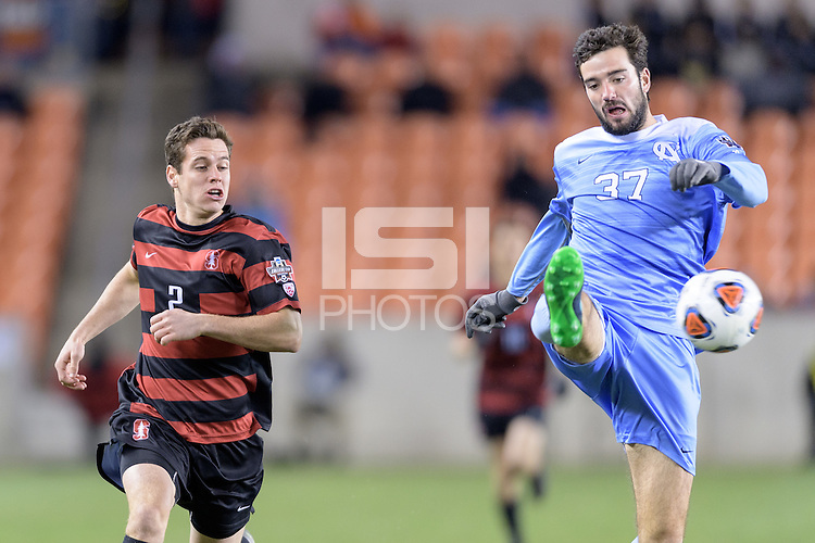 Houston, TX - Friday December 9, 2016: Walker Hume (37) of the North Carolina Tar Heels clears the ball in front of Foster Langsdorf (2) of the Stanford Cardinal at the NCAA Men's Soccer Semifinals at BBVA Compass Stadium in Houston Texas.