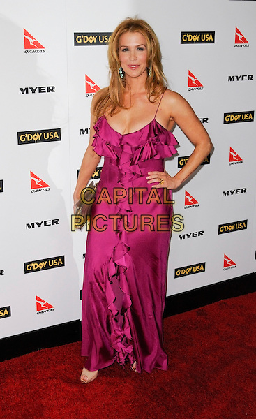 POPPY MONTGOMERY.The G'Day USA Australia Week 2010 Black Tie Gala in the Grand Ballroom at Hollywood & Highland in Hollywood, California, USA.  .January 16th, 2010.full length magenta pink purple ruffle ruffles long maxi dress hand on hip clutch bag gold .CAP/ROT.©Lee Roth/Capital Pictures.