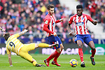 Atletico de Madrid's Lucas Hernandez (c) and Thomas Partey (r) and Girona FC's Portu during La Liga match. January 20,2018. (ALTERPHOTOS/Acero)