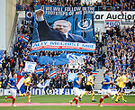 The teams emerge under the gaze of Rangers legend Ally McCoist