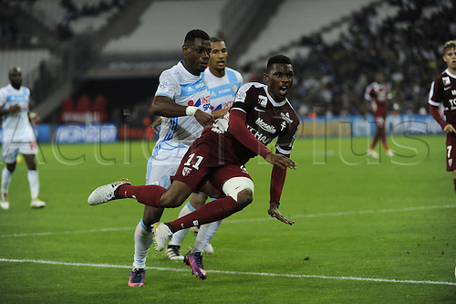 16.10.2016. Marseille, France. French league 1 football. Olympique Marseille versus Metz.  N'Guette (Metz) challenged by Bedimo (OM)